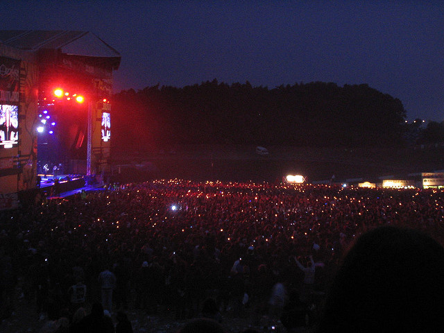 Ozzy Osbourne playing at Download Festival with the crowd waving their lighters